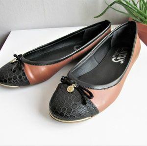 Sam Edelman circus cognac and black cap toe flats
